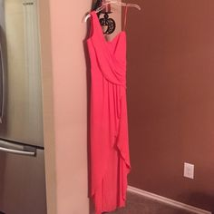 Light orange/pink dress Small slit on the leg. One shoulder. Worn once. Great condition. BCBGMaxAzria Dresses Maxi