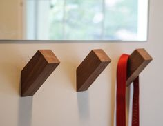 """Slanted walnut or oak wall hooks for the ultimate """"look how little I tried"""" storage solution. 33 Minimalist Home Products That'll Soothe Your Soul Modern Coat Hooks, Modern Wall Hooks, Diy Wall Hooks, Wall Coat Hooks, Wood Hooks, Wall Hanger, Hangers, Cool Walls, Minimalist Home"""