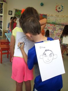 "*literacy extension: ""get to know your HHC friends""--students write 3 words to describe their art partner (socio-emotional dev.)---create a word bank to choose from.  back-2-back game 