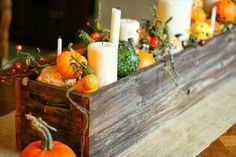 Fall Table Centerpiece - made from old fence boards and filled with candles, pumpkins and gourds. Bunches and Bits.