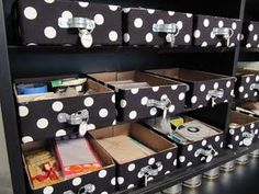 Clutter-Free Classroom {Craft/Scrapbook} Storage. This looks like bulk size cardboard boxes prettied up, could use printed duck tape and simple plumbing supplies for pulls.