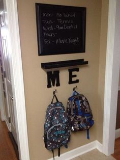 """My mini drop zone:  chalkboard """"contact"""" paper, large frame, chalk tray, each child's initials and hooks.  Very inexpensive and super easy to put together!"""