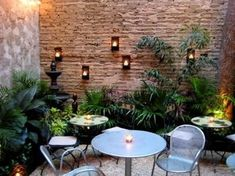 Small courtyard design with wall mounted candles – great little patio space. Small courtyard design with wall mounted candles – great little patio space. Modern Courtyard, Small Courtyard Gardens, Courtyard Design, Small Courtyards, Terrace Garden, Small Gardens, Garden Club, Brick Courtyard, Patio Courtyard Ideas