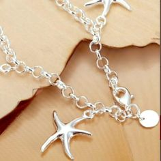"""Starfish Bracelet NWT Retail  This is such a lovely bracelet! It's sterling silver 925. It's just under 8"""".                                Trades  PayPal  Holds Modeling PetsSmoke *I do my best to describe each product. There may be a slight color variation in person from what you see on the computer. Always ask any questions before purchasing  Jewelry Bracelets"""