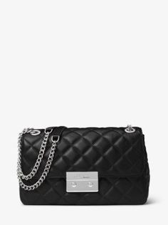 Our Sloan bag combines luxe quilted leather with a chain-trimmed shoulder strap to form one haute handbag. Tempered by modern hardware and a structured silhouette, this chic style chameleon will go from elegant to edgy with a simple outfit swap.