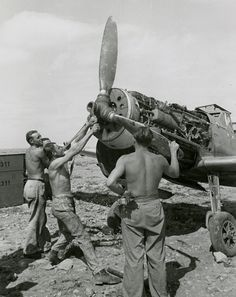 Luftwaffe mechanics perform ground maintenance on a Messerschmitt Bf 109 of III. One man uses a large wrench to handle the plane's propeller. Ww2 Aircraft, Fighter Aircraft, Military Aircraft, Luftwaffe, Fighter Pilot, Fighter Jets, Bomber Plane, Old Planes, Afrika Korps