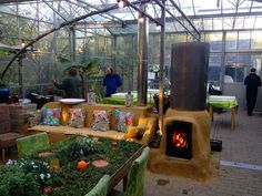 Greenhouse Rocket Mass Heater by Sjang Van Daal from Vuur & Leem - Rocket Stove Workshops, Netherlands