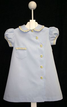 Children's Corner Pattern Jennie Leigh from #15 Aprons is classic side button dress. This one was made by Jennie Abrams. #15 Aprons comes in sizes 6-12-18 months and sizes 2-3-4.