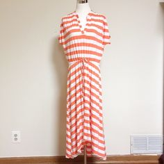 Olivia Moon-orange striped summer dress-size M Olivia Moon-orange and white striped high low spring or summer dress-size Medium. Short sleeve, v neck, enclosed drawstring at waist. Style #: axc9832w. 47% polyester, 47% rayon, 6% spandex. Olivia Moon Dresses High Low
