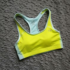 Racerback sports bra Lightly padded (removable pads). Mesh back. Bright green and light blue. No tags but never worn. Champion Intimates & Sleepwear Bras