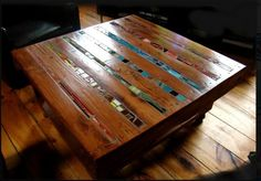 table made with 2x4's, cracks are filled in with thin and subtle mosaic. Nice way to add pops of color. :)