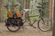 Home-built longtail bike with two kid seats. Super equipped! _ Bici aggiustata in casa con lungo telaio e posto a sedere ulteriore per due bambini. Super attrezzata! - (from http://hikebike.net)