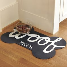 "Protect your precious floors from your dog's messy eating habits with this ""Woof"" dog bowl mat from Ballard Designs. And guess what? You can customize it by adding a monogram of… Food Dog, Dog Food Recipes, Dog Bowl Mat, Pet Bowls, Cute Dog Bowls, Ballard Designs, Dog Accessories, Dog Bed, Schnauzer"