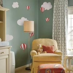 "Cute hot air balloon decals that children love! Perfect for your nursery or playroom. Size: Largest Hot air balloon Size: (approx): 6"" wide Largest Cloud Size: (approx): 11.5"" wide What's Included: Se"
