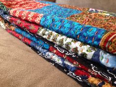 Close up of kantha thread embroidery and block prints on this patchwork kantha quilt.