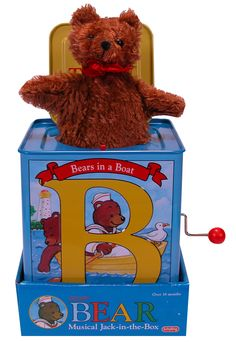 These multicolor tin Jack-In-the-Box-type toys have illustrations of bears in various activities on the sides. Description from cpsc.gov. I searched for this on bing.com/images