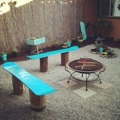 Snowboard benches around a fire pit