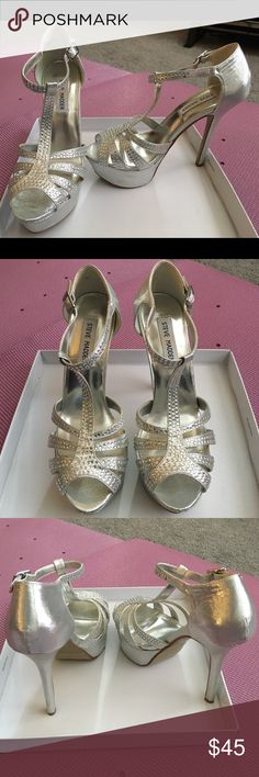 Silver Steve Madden heels Silver, dressy heels. Open toed with studs on the front. Tie at ankle. Tall. Almost brand new. Worn maybe once or twice. Steve Madden Shoes Heels