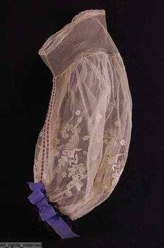 1860s tulle undersleeves with tambour embroidery, insertion threaded with narrow lilac ribbon, cuff in purple taffeta ribbon and black machine lace. Click through for excellent detail views. ModeMuseum Provincie Antwerpen. http://openfashion.momu.be:9879/Default.aspx?lng=nl#1b69b5ff-5567-4deb-831c-8dd7d7030e4c (Pinterest dings this link -- copy and paste.)