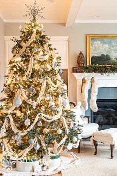 Our latest Christmas tree in our living room includes some new pieces and some old favorites: white string lights, white finger knit garland, wool pom garland, grain sack tree skirt, and vintage green hat boxes. Plus a variety of ornaments in silver, cream, blue, and gray - in textures of metal, glass, fabric, clay, papier-mache, bottle brush, and more. And, my Wallace silver Sleigh bells collection. - Miss Mustard Seed #missmustardseed #christmastree   vintage & antique holiday decor Christmas Tree Yarn, Christmas Tree Themes, Cozy Christmas, Christmas Decorations To Make, Christmas Colors, Holiday Decor, White Christmas, Seasonal Decor, Holiday Ideas