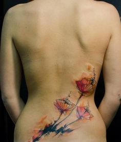 red and black poppy watercolour tattoo - lower back