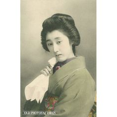 1910's. Woman with Handkerchief. A young Japanese woman in kimono and traditional hairstyle is holding a handkerchief to her chin. This postcard was published sometime between 1907 and 1918. During the early 20th century, picture postcards of bijin (beautiful women) were extremely popular in Japan.