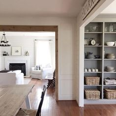 I really love the rustic post and lintel look of barn wood beams in a doorway. I knew the real thing wasn't going to happen in our home any time soon, so instead I looked for a way to get the l Wood Door Frame, Wood Doors, Faux Wood Beams, Wood Trim, Decor Pad, Door Casing, Old Barn Wood, Doorway, Home Remodeling