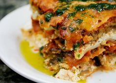 Hearty Vegetable Lasagna Recipe (bday dinner!) : This veggie lasagna satisfied the order for a hearty birthday dinner for the hubbs.  Definitely a keeper, but cut back on the cheese next time.  Also, made this with the roma tomato sauce recipe by Oprah (also pinned to this board).