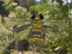 Stained glass suncatcher of a Beveled Bee