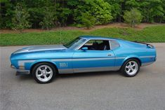 "Lot #212 1972 #FORD #MUSTANG #MACH 1 #CUSTOM #FASTBACK 351cid Cleveland with 4-barrel carburetor. Bright Blue metallic Code 3J with black interior. Automatic FMX transmission Code X. #Power steering and power front disc brakes. Console with clock, radio and 8,000 rpm tach. 17"" #American #Racing #wheels and #Flowmasters. #BarrettJackson #auto #auction #car #cars #forsale"
