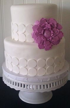 Inspiration for a modern girl's birthday cake I would like it better though if the dots were purple like the flower
