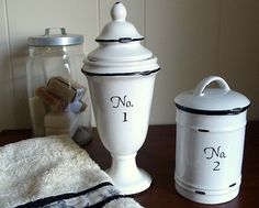 DIY:  How to Paint Ceramic Apothecary Jars to Look Like Enamelware - letters and numbers are stickers and the lines were painted on, turning thrift store finds into updated home decor items - via An Oregon Cottage