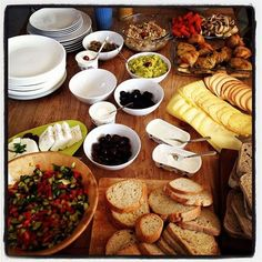 """Israeli breakfast! Cucumbers, tomatoes, etc (we grabbed a cucumber, a tomato, and other veggies and cut up our own salad at our table) plain yogurt """"dressing"""" for the salad, wheat germ on top, and the BREAD! and coffee/tea."""