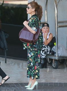 Say it with flowers: The We Own The Night star wowed as she stepped out in a black-and-green floral suit