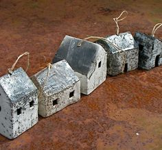 Rowboat:  Smaller ceramic houses strung with hemp string for hanging.   All pieces are hand made and hand fired, so they will vary in shape and colour.   Approximate size:   houses: height 3-5 cms