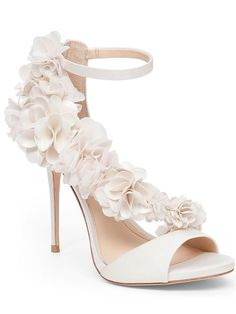 Rock white wedding shoes with trendy texture to make a romantic statement with frothy, cascading rosettes and a dainty ankle strap. #weddingshoe #weddingshoes