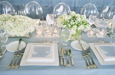 Carneros Inn, Napa.  Blue and white linens with white flowers and votives.    Read more - http://www.stylemepretty.com/2011/03/17/napa-valley-wedding-by-jose-villa-2/