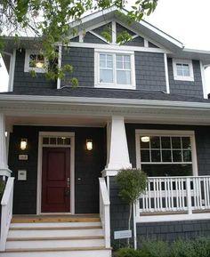 grey house with deep red door