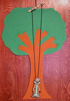 """Zacchaeus Climbs the Tree.  This """"toy"""" allows Zaccheus to rise on the string, up into the tree, when a child pulls the two strings gently back and forth.  What a great use for this old-timey toy!"""