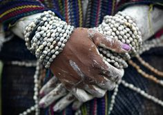 Mindima widows wear many stands of  seed (Job's tears) necklaces around her neck and arms during mourning .The woman will remove one strand/necklace of seeds each day while in mourning.  Only once she has been in mourning long enough to be able to remove all the stands can she then was herself and find a new husband. |  Papua New Guinea.