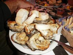 Acme Oyster House (charbroiled oysters)