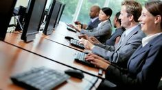 stock-footage-team-male-female-business-people-working-in-center-trading-stocks-