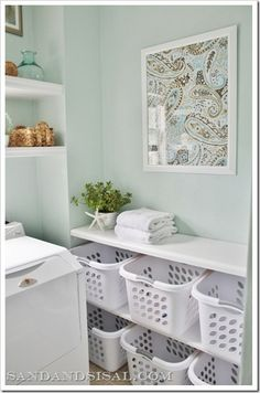 Not only are the shelves for the laundry baskets a neat idea, there are also instructions to create .Framed Fabric Art