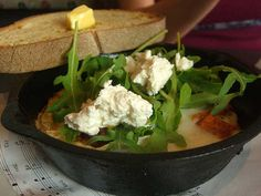 Baked Eggs with Roasted Sweet Potatoes, Rocket and Goats Curd Cheese