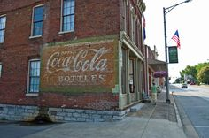 An original Coca Cola sign painted on the side of a building in downtown Munfordville, Kentucky.