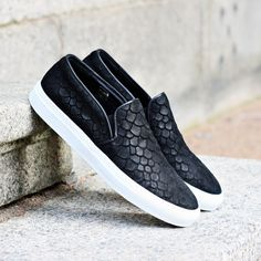 Axel Arigato black fish embossed suede slip-on with a classic design and leather trim, handcrafted with premium Italian materials. White Italian rubber cup-sole from Margom. #axelarigato www.axelarigato.com