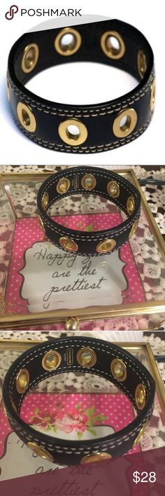 Coach Black Leather Grommet Bracelet Coach patent leather grommet bracelet. Gently loved but still plenty of life left. 8 inches all around. There is some pink marking shown in last picture. Coach Jewelry Bracelets