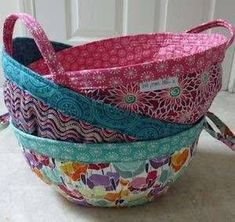 Pattern designed by Beth Studley This hugely popular pattern provides perfect storage for work in progress craft projects like knitting, English paper piecing or patchwork blocks. Who doesn't have more than one project on the go? They are also great for general storage around the home. The shape is achieved using darts and the baskets can be made with or without handles depending on your preference. The pattern uses both wadding and interfacing for stability and the top is reinforced to…