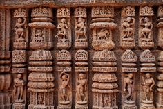 These sculptures are found in the Konarak Sun Temple, Odisha state, India. Carved in the temple wall, these show women in various poses, as singers and playing.