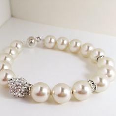 A personal favorite from my Etsy shop https://www.etsy.com/listing/244731407/pearl-bracelet-elegant-bracelet